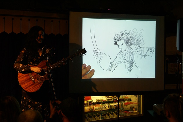Emily Mae Winters with live drawing by Chris Riddell
